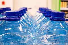 Plastic bottles with water 5 liters. On the market Stock Photos