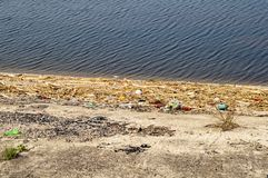Plastic bottles on the waterfront royalty free stock photography