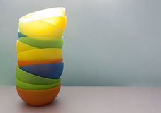 Plastic bowls in the kitchen. Against blur background Royalty Free Stock Photos