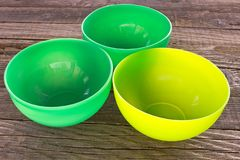 Plastic bowls on wooden table background. Plastic bowls on old wooden table background royalty free stock images