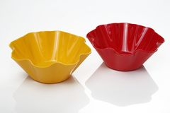 Plastic Bowls, Plastic Snack Bowls, white background. Red & yellow plastic snack bowls on white background stock photography