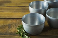 Plastic bowls and rosemary herb Royalty Free Stock Images