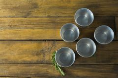 Plastic bowls and rosemary herb Royalty Free Stock Photography