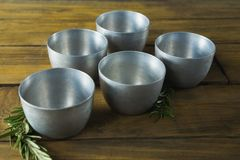 Plastic bowls and rosemary herb Stock Images