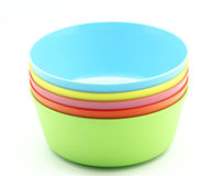 Plastic bowls. In various colors on white background royalty free stock images