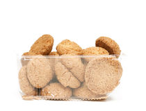 Plastic box of almond cookies. On white background Stock Photos