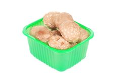 Plastic box with champignons. Stock Image