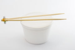 Plastic box with chopsticks Royalty Free Stock Images