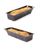 Plastic box filled with cookies isolated. Plastic box filled with oatmeal thin cookies isolated over the white background, set of two different foreshortenings Royalty Free Stock Photos