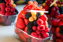 Plastic box of fresh healthy fruit. Currant and strawberry Royalty Free Stock Image