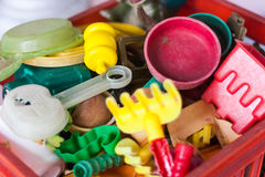 Plastic box full of old sand toys Royalty Free Stock Photos