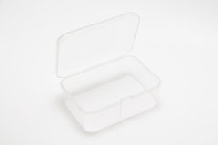 Plastic box. Open empty transparent plastic box on white background stock photo