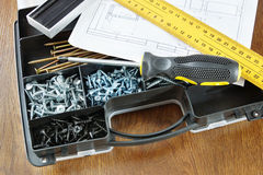 Plastic box with screws and screwdriver Stock Images