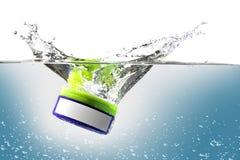 Plastic box splash Stock Photography