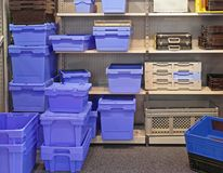 Plastic Boxes. Bins Trays and Boxes For Parts and Tools Storage in Shelf stock photos