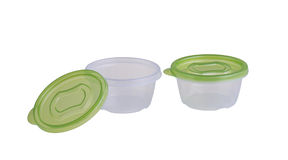Plastic boxes with green lids Stock Photography