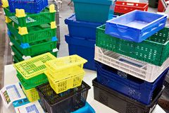 Plastic boxes for transportation of goods and trade. On showcase stock images