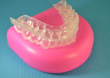 Plastic braces to straighten teeth Royalty Free Stock Photo