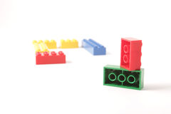 Plastic bricks. In different colors royalty free stock photo