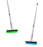 Plastic brooms isolated on white Royalty Free Stock Photos