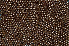 Plastic brown bead Royalty Free Stock Images