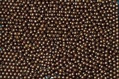 Plastic bruine parel Royalty-vrije Stock Afbeeldingen