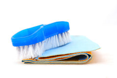 Plastic brush on cleaning cloths Royalty Free Stock Photos