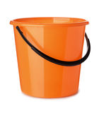 Plastic bucket. Orange plastic bucket isolated on white Stock Images