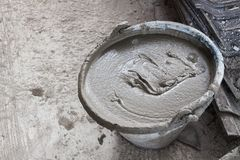 Plastic bucket put cement for construction. Royalty Free Stock Images