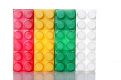 Plastic buidling blocks over white Royalty Free Stock Images