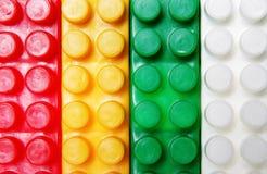 Plastic building blocks background Stock Image