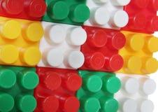 Plastic building blocks background Stock Photos