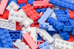Plastic Building Blocks. Pile of Red, White and Blue Toy Plastic Building Blocks stock photography