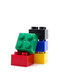 Plastic building blocks on white background Stock Images