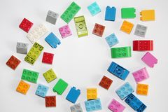 Plastic building blocks on a white background. Multi-colored cubes royalty free stock images