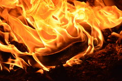 Plastic burning. This is a photo of some plastic engulfed in flames burning in a fire Royalty Free Stock Images