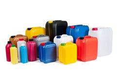 Plastic bussen voor machineolie Stock Afbeelding