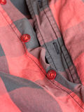Plastic button on a shirt Royalty Free Stock Photo