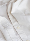 Plastic button on a shirt Royalty Free Stock Photos