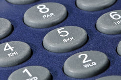 Plastic buttons on a blue gadget. Royalty Free Stock Photo
