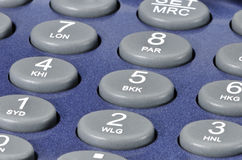 Plastic buttons on a blue gadget. Stock Image
