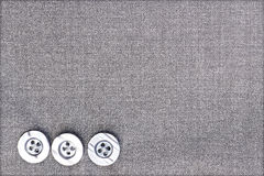 Plastic buttons on fabric Royalty Free Stock Photos