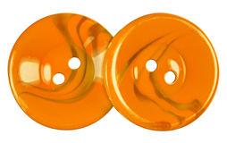 Plastic buttons isolated - orange Stock Images
