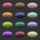 Plastic buttons. Oval plastic buttons on a dark gray background Stock Image