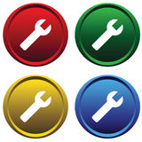 Plastic buttons with tool Royalty Free Stock Images