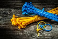 Plastic cables on vintage wooden board royalty free stock photo