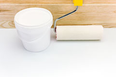 Plastic can of paint with paint roller Royalty Free Stock Image