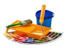 Plastic can with paint, roller, brushes and bright Royalty Free Stock Images