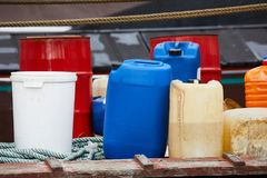 Plastic cans of chemicals. Various plastic cans with chemicals and fuel Royalty Free Stock Image