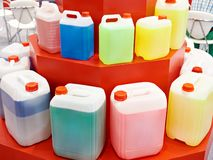 Plastic cans with color liquids. Plastic cans with colored liquids Royalty Free Stock Image